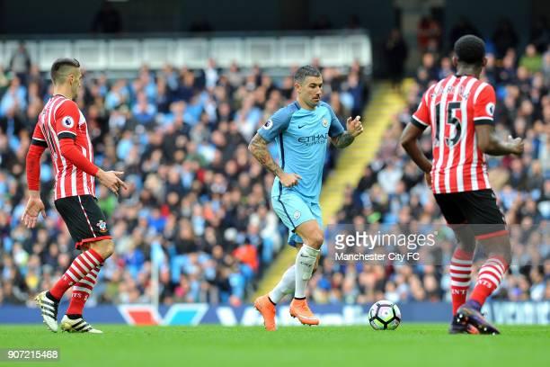 Manchester City v Southampton Premier League Etihad Stadium Manchester City's Aleksandar Kolarov and Southampton's Dusan Tadic and Cuco Martina in...