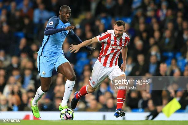 Manchester City v Stoke City Premier League Etihad Stadium Manchester City's Yaya Toure Stoke City's Phil Bardsley battle for the ball