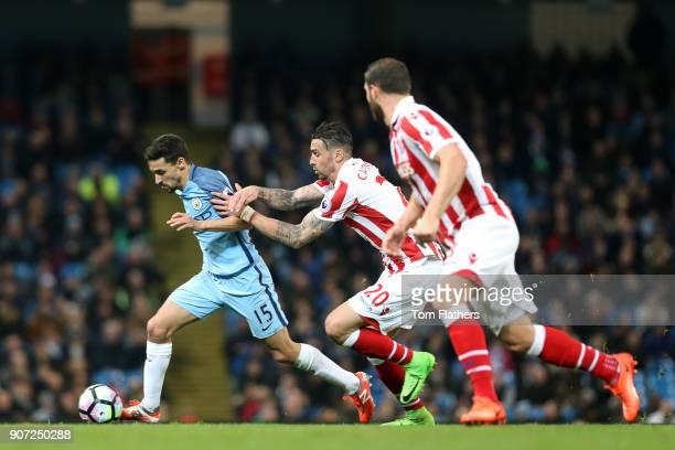Manchester City v Stoke City Premier League Etihad Stadium Manchester City's Jesus Navas and Stoke City's Geoff Cameron battle for the ball