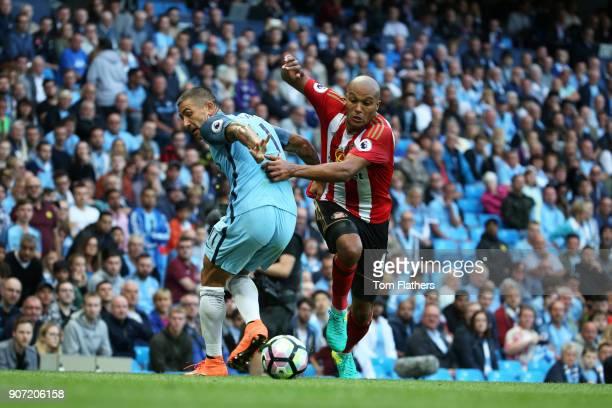 Manchester City v Sunderland Premier League Etihad Stadium Aleksandar Kolarov of Manchester City competes with Youns Kaboul of Sunderland during...