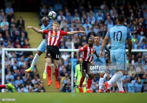 Manchester City v Sunderland Premier League Etihad Stadium Fernandinho of Manchester City competes with Duncan Watmore of Sunderland during the...