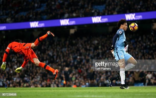 Manchester City v Tottenham Hotspur Premier League Etihad Stadium Manchester City's Leroy Sane gets past Tottenham Hotspur goalkeeper Hugo Lloris to...