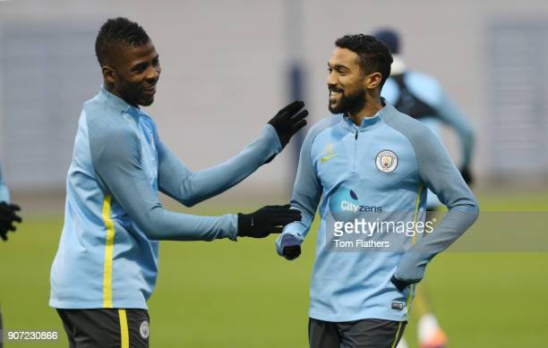 Manchester City v Watford Premier League Manchester City Training City Football Academy Manchester City's Kelechi Iheanacho and Gael Clichy smile in...