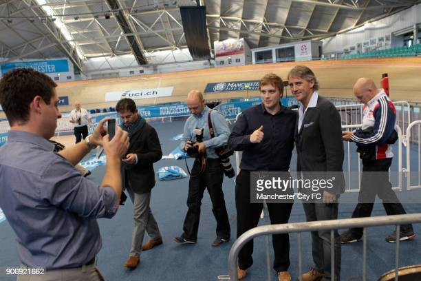 Manchester City Velodrome Visit Performance Director of British Cycling David Brailsford with Manchester City manager Roberto Mancini