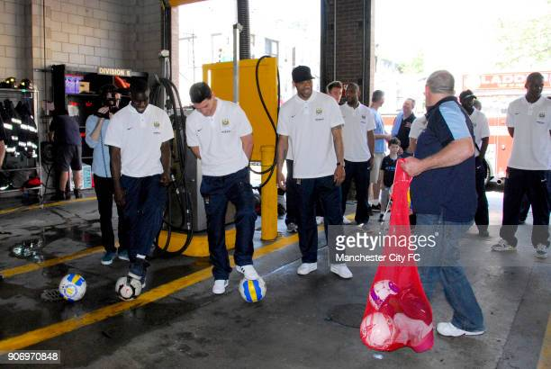 Manchester City visit NYFD New York Micah Richards Gareth Barry and Joleon Lescott get ready to show their skills visiting FDNY on post season tour...