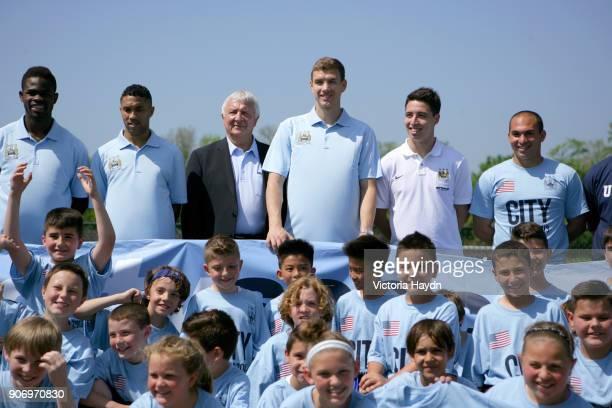 Manchester City visit Staten Island New York Abdul Razak Gael Clichy Mike Summerbee Edin Dzeko Samir Nasri all pose for a group picture at Staten...