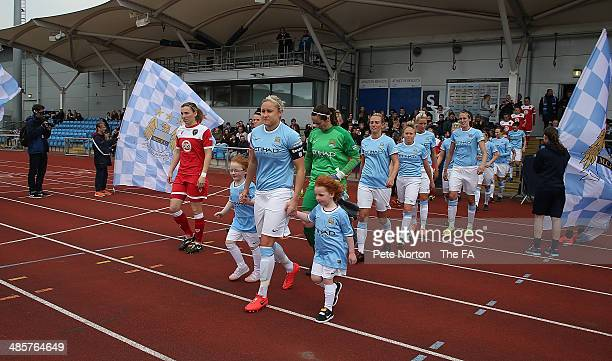 Manchester City Women captain Steph Houghton and Bristol Academy Women capatin Corrine Yorsten lead out the teams prior to the FA WSL 1 match between...