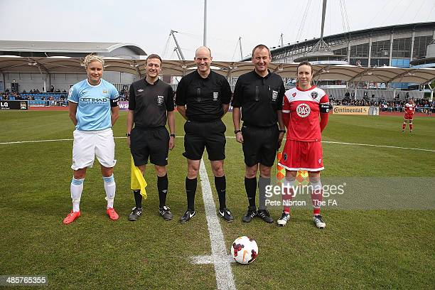 Manchester City Women captain Steph Houghton and Bristol Academy Women capatin Corrine Yorsten line up with referee Duncan Street and assistants...