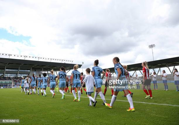 Manchester City Women's and Sunderland Ladies' players make their way out on to the pitch