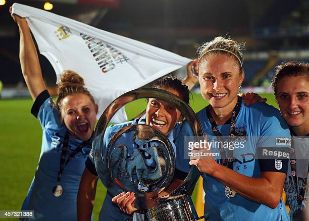 Manchester City Women's Captain Steph Houghton poses with the trophy after winning the FA WSL Continental Cup Final between Arsenal Ladies and...