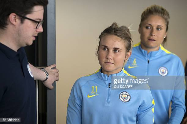 Manchester City Women's Football Club players Izzy Christiansen and Steph Houghton arrives to meet the media at the City Football Academy in...
