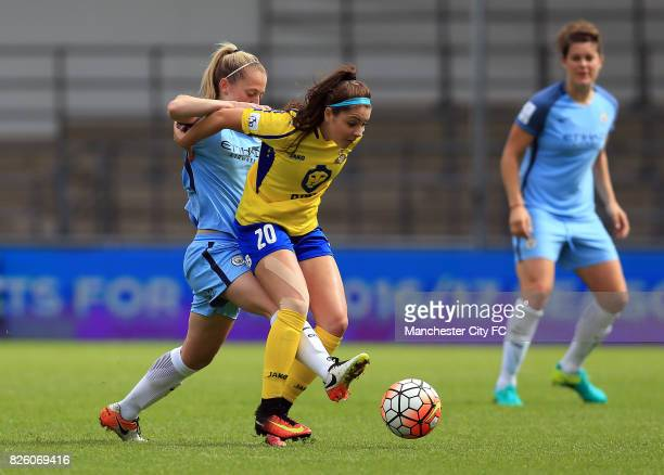 Manchester City Women's Keira Walsh and Doncaster Rovers Belles' Carla Humphrey battle for the ball