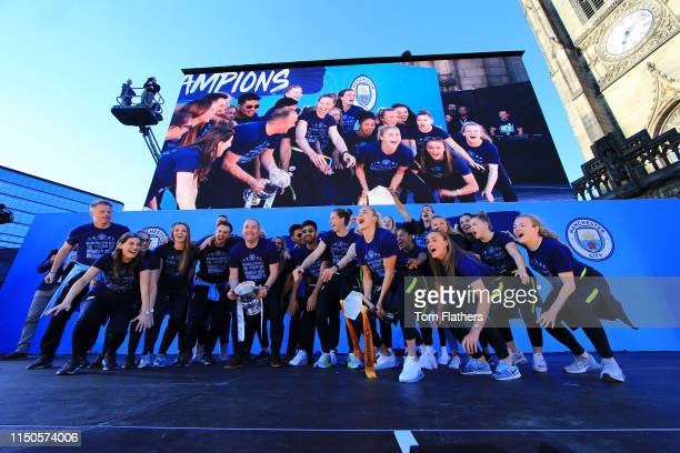 Manchester City Women's players celebrate on the stage during the Manchester City Teams Celebration Parade on May 20 2019 in Manchester England