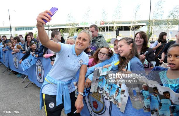 Manchester City Women's Steph Houghton signs autographs and poses for selfies with mascots and fans