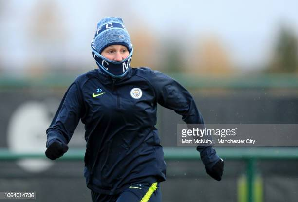 Manchester City's Abbie McManus wears a hat and scarf during the training session at Manchester City Football Academy on November 20 2018 in...