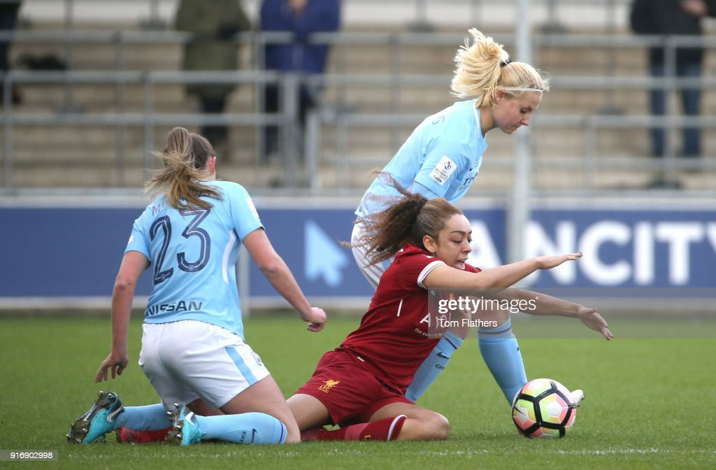 Manchester City's Abi McManus and Mie Jans in action at the Academy Stadium during the FA WSL 1 match between Manchester City Women and Liverpool Ladies on February 11, 2018 in Manchester, England.