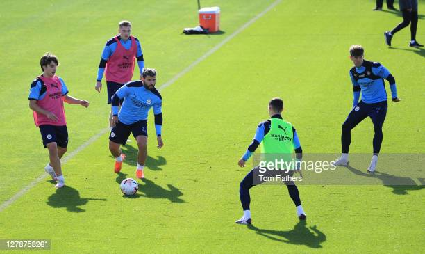 Manchester CIty's Adrian Bernabe Liam Delap Sergio Aguero Phil Foden and John Stones in action during training at Manchester City Football Academy on...