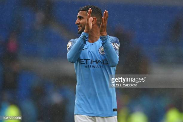Manchester City's Algerian midfielder Riyad Mahrez applauds supporters on the pitch after the English Premier League football match between between...