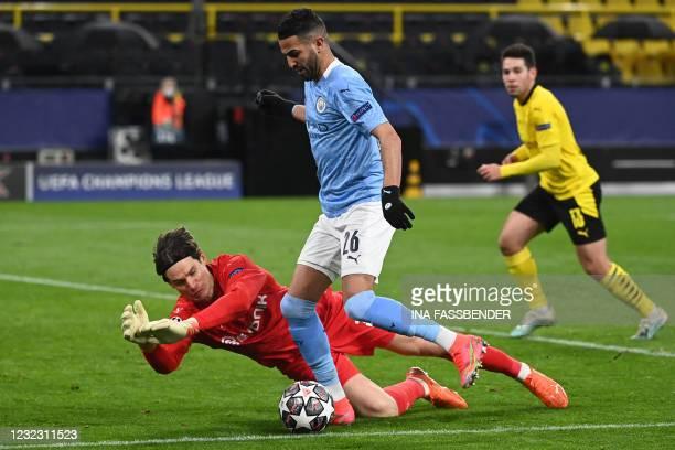 Manchester City's Algerian midfielder Riyad Mahrez attempts to score past Dortmund's Swiss goalkeeper Marwin Hitz during the UEFA Champions League...