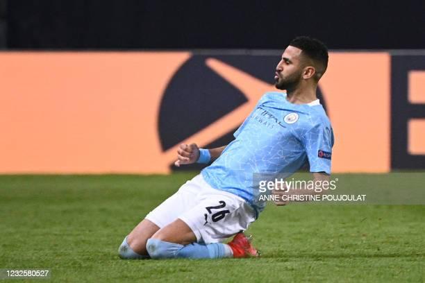 Manchester City's Algerian midfielder Riyad Mahrez celebrates after scoring a goal during the UEFA Champions League first leg semi-final football...