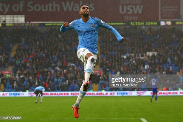 Manchester City's Algerian midfielder Riyad Mahrez celebrates after scoring his second goal their fifth during the English Premier League football...