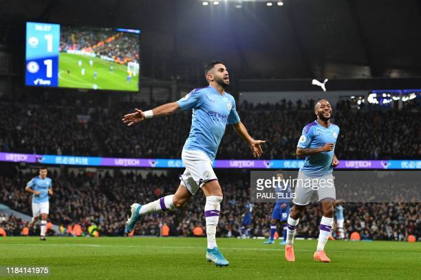 TOPSHOT Manchester City's Algerian midfielder Riyad Mahrez celebrates after scoring their second goal during the English Premier League football...