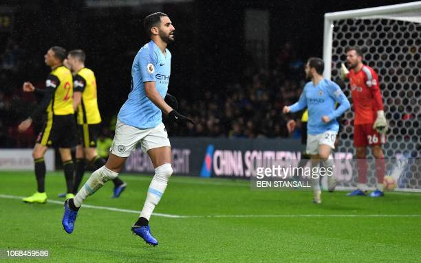 Manchester City's Algerian midfielder Riyad Mahrez celebrates scoring his team's second goal during the English Premier League football match between...