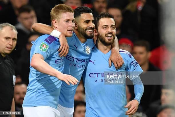 Manchester City's Algerian midfielder Riyad Mahrez celebrates scoring his team's second goal with Manchester City's Belgian midfielder Kevin De...