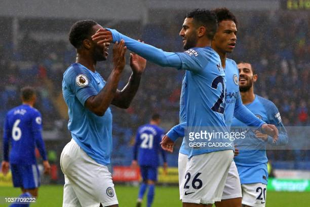 Manchester City's Algerian midfielder Riyad Mahrez celebrates with teammates after scoring his second goal their fifth during the English Premier...