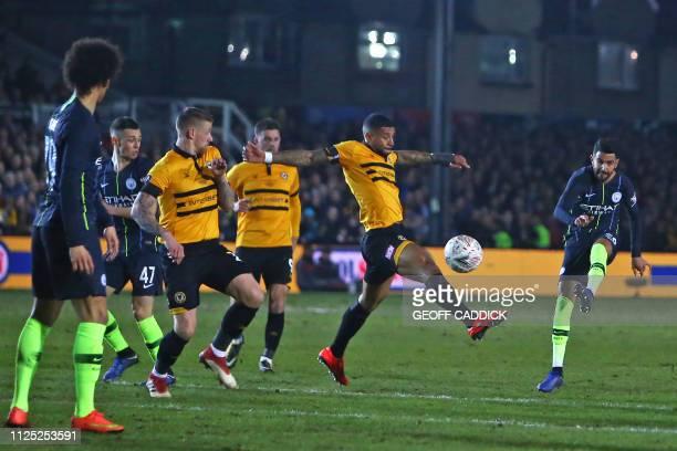 Manchester City's Algerian midfielder Riyad Mahrez has an unsuccessful shot during the English FA Cup fifth round football match between Newport...