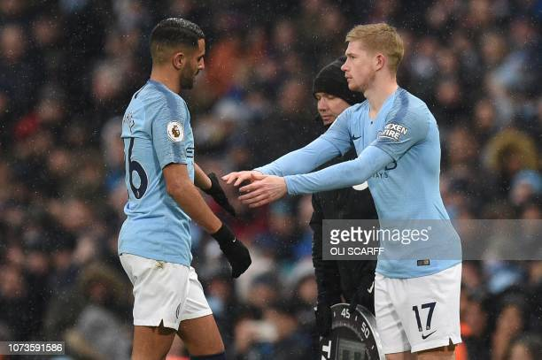 Manchester City's Algerian midfielder Riyad Mahrez leaves the pitch after being substituted off for Manchester City's Belgian midfielder Kevin De...
