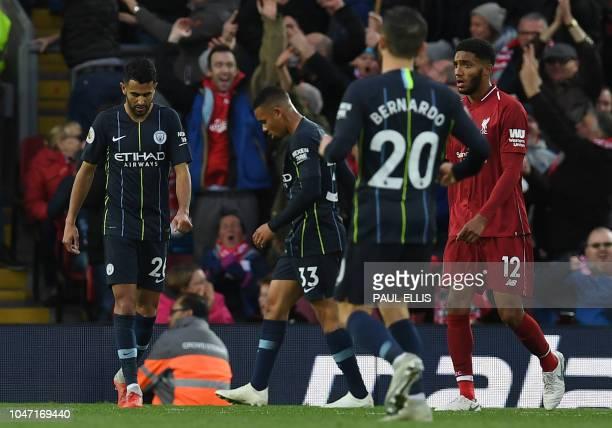 Manchester City's Algerian midfielder Riyad Mahrez passes Manchester City's Brazilian striker Gabriel Jesus and Manchester City's Portuguese...