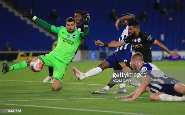 Manchester City's Algerian midfielder Riyad Mahrez puts the ball wide past Brighton's Australian goalkeeper Mathew Ryan during the English Premier...
