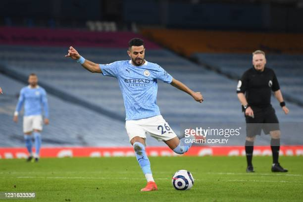 Manchester City's Algerian midfielder Riyad Mahrez scores his team's fourth goal during the English Premier League football match between Manchester...