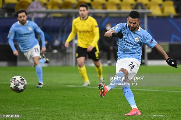 Manchester City's Algerian midfielder Riyad Mahrez scores the 1-1 goal from the penalty spot during the UEFA Champions League quarter-final second...
