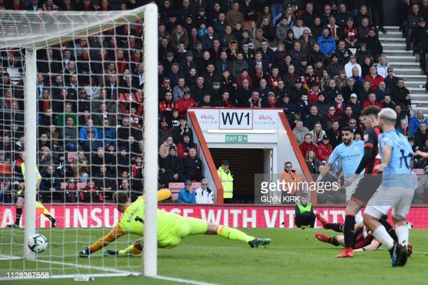Manchester City's Algerian midfielder Riyad Mahrez scores the opening goal past Bournemouth's Polish goalkeeper Artur Boruc during the English...
