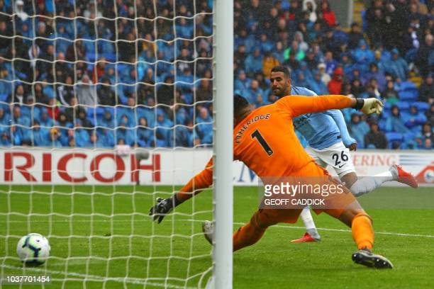 Manchester City's Algerian midfielder Riyad Mahrez shoots past Cardiff City's Englishborn Filipino goalkeeper Neil Etheridge to score their fourth...