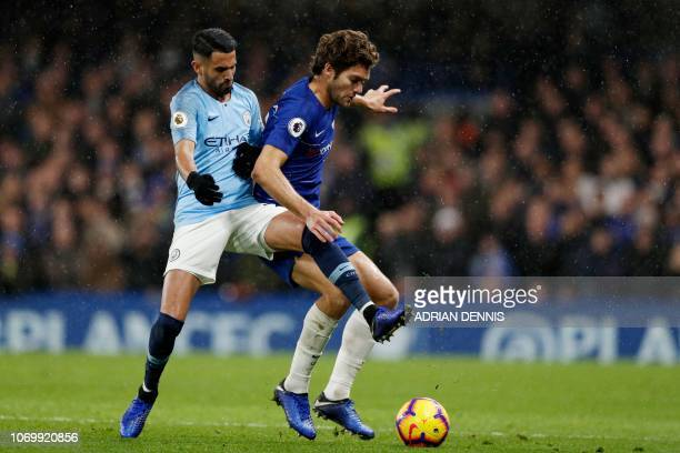 Manchester City's Algerian midfielder Riyad Mahrez vies with Chelsea's Spanish defender Marcos Alonso during the English Premier League football...