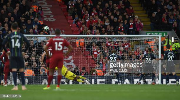 Manchester City's Algerian midfielder Riyad Mahrez watches as his shot from the penalty spot goes over the bar during the English Premier League...