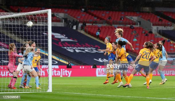Manchester City's American midfielder Sam Mewis jumps to head the ball to score the opening goal from a corner kick during the English Women's FA Cup...