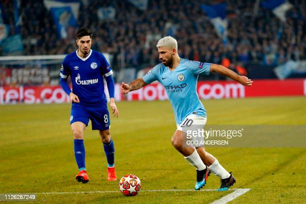 Manchester City's Argentine forward Sergio Aguero runs with the ball during the UEFA Champions League round of 16 first leg football match between...