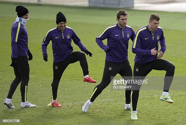 Manchester City's Argentinian defender Martin Demichelis Manchester City's Spanish midfielder David Silva Manchester City's English midfielder Frank...