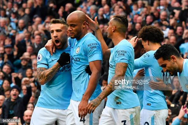Manchester City's Argentinian defender Nicolas Otamendi and Manchester City's Brazilian defender Danilo celebrate with Manchester City's Belgian...