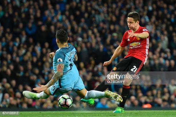 Manchester City's Argentinian defender Nicolas Otamendi blocks a shot from Manchester United's Spanish midfielder Ander Herrera during the English...