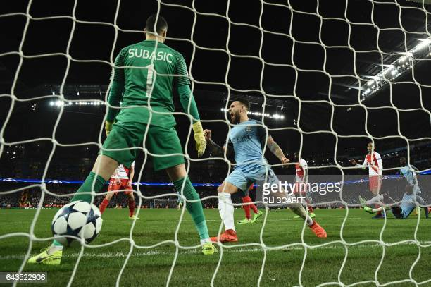 TOPSHOT Manchester City's Argentinian defender Nicolas Otamendi celebrates after Manchester City's English defender John Stones scored their fourth...
