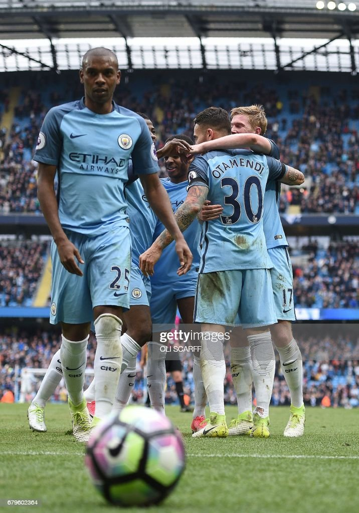 Manchester City's Argentinian defender Nicolas Otamendi (2R) celebrates scoring his team's fifth goal during the English Premier League football match between Manchester City and Crystal Palace at the Etihad Stadium in Manchester, north west England, on May 6, 2017. Manchester City won the match 5-0. / AFP PHOTO / Oli SCARFF / RESTRICTED TO EDITORIAL USE. No use with unauthorized audio, video, data, fixture lists, club/league logos or 'live' services. Online in-match use limited to 75 images, no video emulation. No use in betting, games or single club/league/player publications. /
