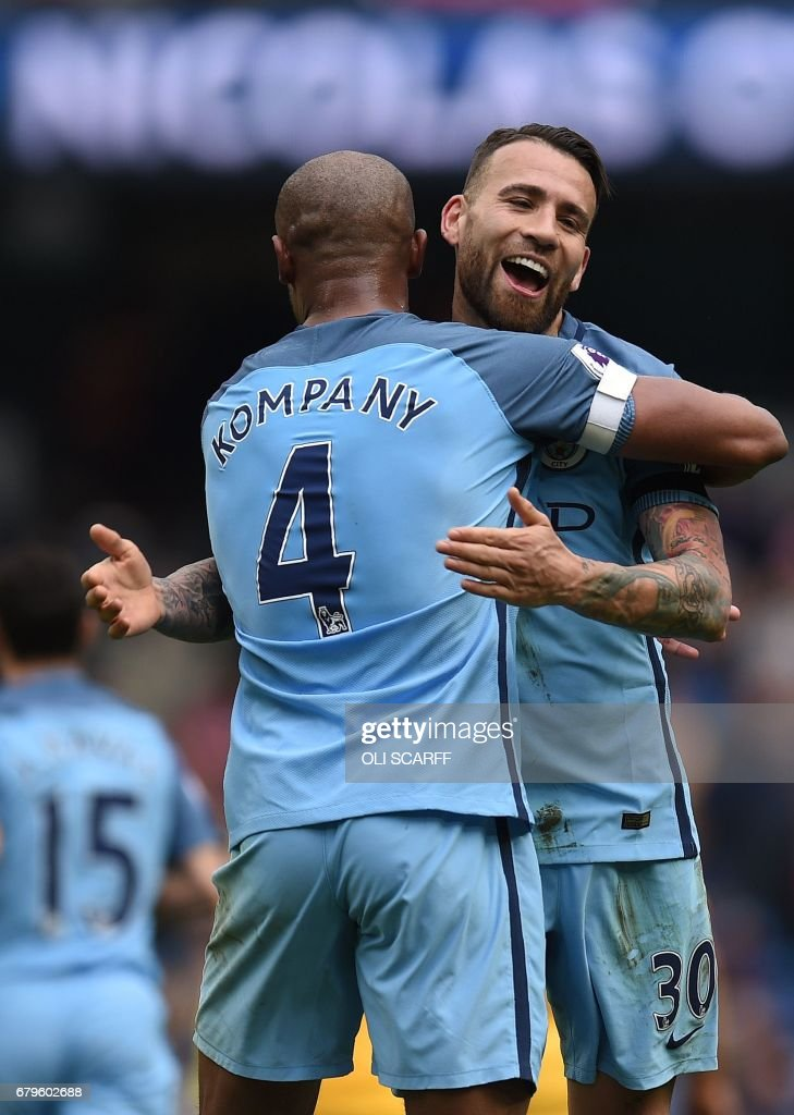 Manchester City's Argentinian defender Nicolas Otamendi (R) celebrates scoring his team's fifth goal with Manchester City's Belgian defender Vincent Kompany during the English Premier League football match between Manchester City and Crystal Palace at the Etihad Stadium in Manchester, north west England, on May 6, 2017. Manchester City won the match 5-0. / AFP PHOTO / Oli SCARFF / RESTRICTED TO EDITORIAL USE. No use with unauthorized audio, video, data, fixture lists, club/league logos or 'live' services. Online in-match use limited to 75 images, no video emulation. No use in betting, games or single club/league/player publications. /