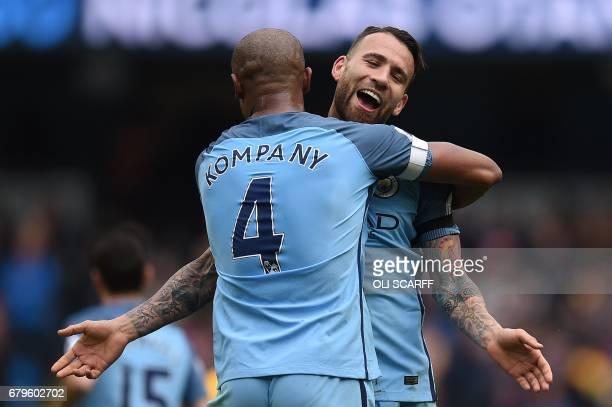 Manchester City's Argentinian defender Nicolas Otamendi celebrates scoring his team's fifth goal with Manchester City's Belgian defender Vincent...