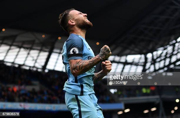 Manchester City's Argentinian defender Nicolas Otamendi celebrates scoring his team's fifth goal during the English Premier League football match...