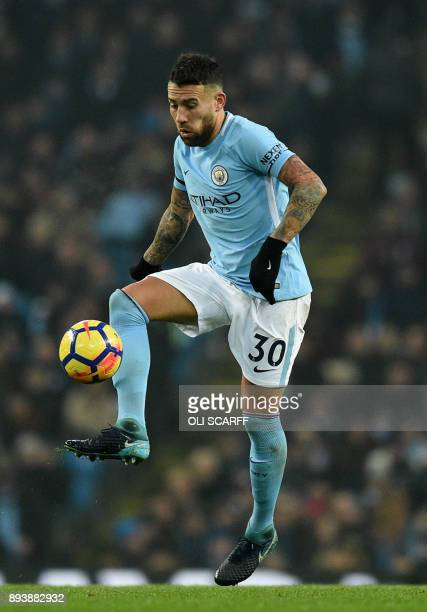 Manchester City's Argentinian defender Nicolas Otamendi controls the ball during the English Premier League football match between Manchester City...
